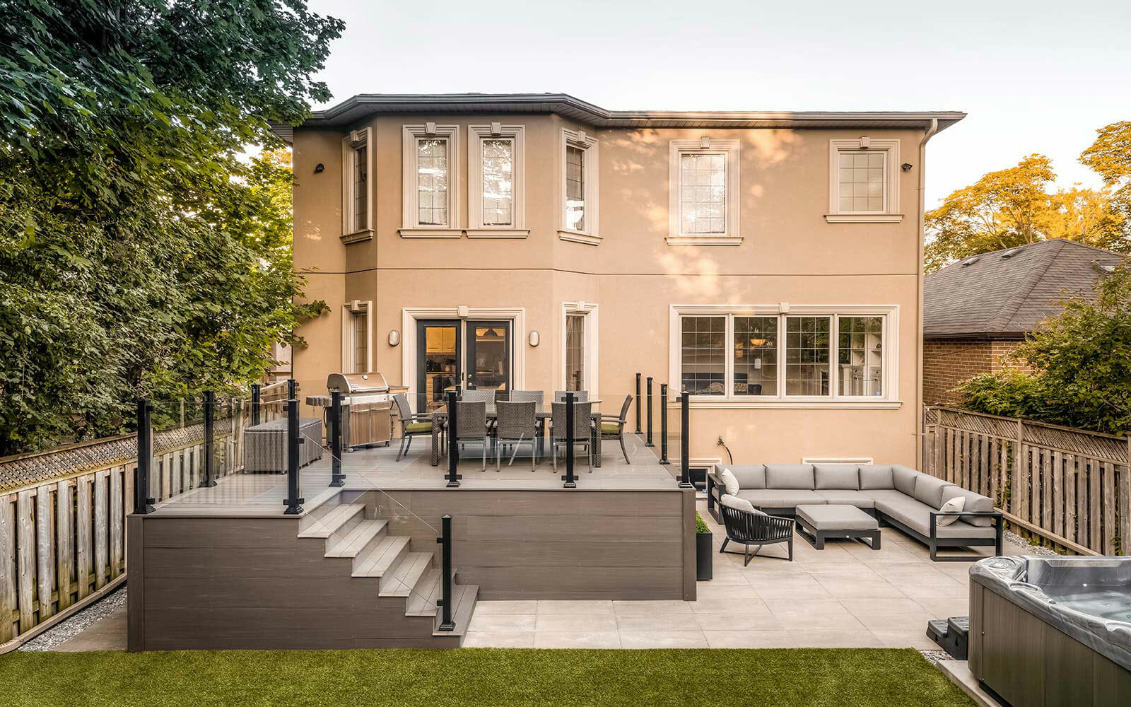AZEK Decking Project Toronto; Featuring Patio Design, Interlocking, Privacy Fence & Aluminum Glass Railings by Toronto Landscaping Company.