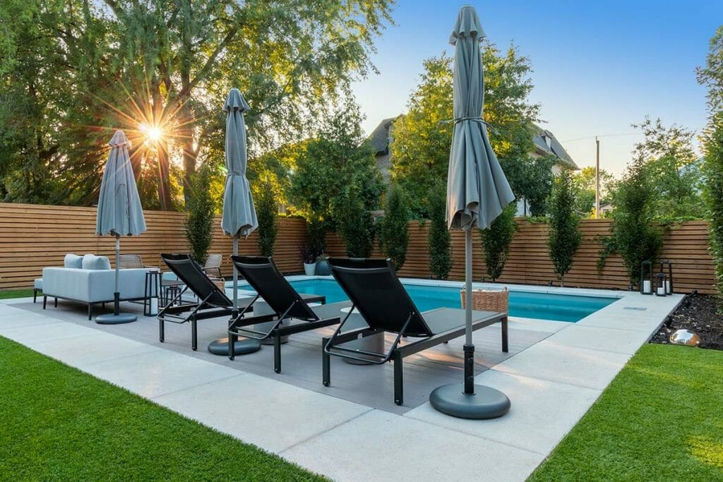 Toronto Backyard, Complete Landscaping Project by M.E. Contracting; Featuring Fiberglass Pool Installation, Landscape Design, PVC Decking, Stone Interlocking & Softscape