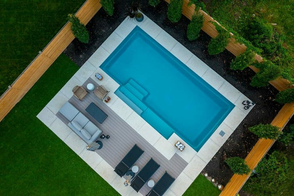 Toronto Landscape Design Project; Featuring Fiberglass Pool Installation, Small Pool Deck Interlocking, Softscape & PVC Decking by M.E. Contracting.