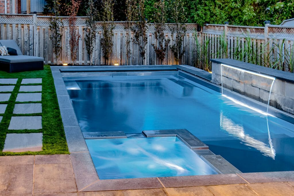 Charbel Toronto Landscaping Design & Pool Construction Project with Water Feature by M.E. Contracting.