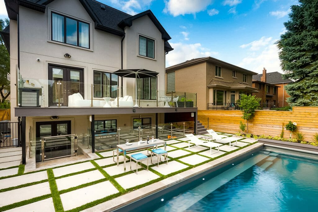 Complete Landscape Design Project on Joicey Blvd; Featuring Interlocking, Fiberglass Pool, Outdoor Fireplace & Kitchen, TREX Decking with Stainless Steel & Glass Railings