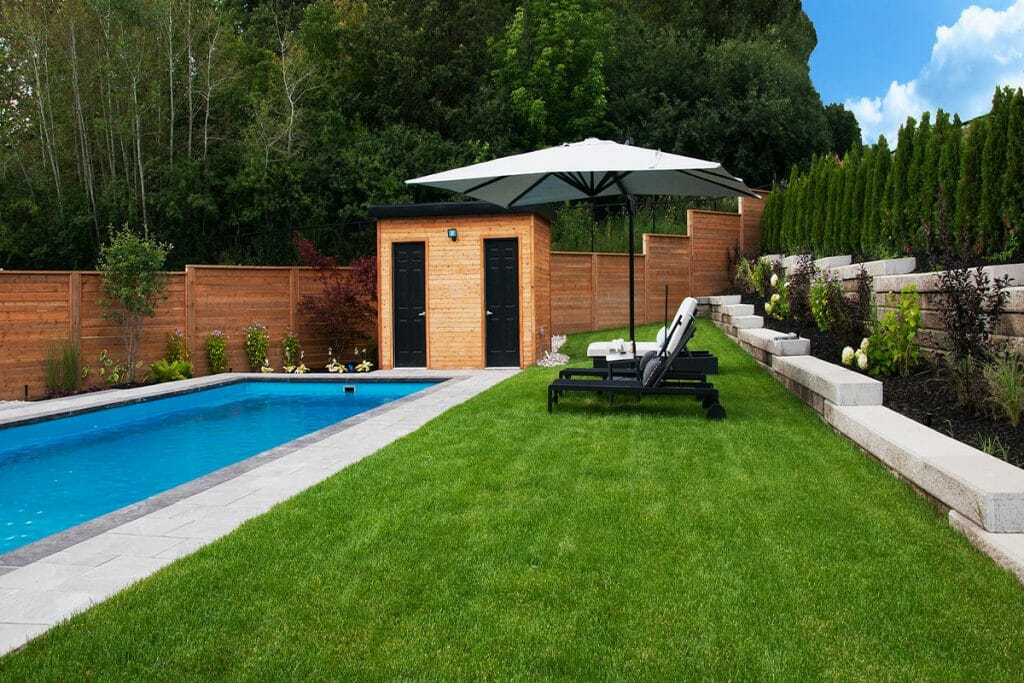 Complete Landscape Project by M.E. Contracting; Featuring Pool Installation, Retaining Wall, Interlocking & Woodwroking