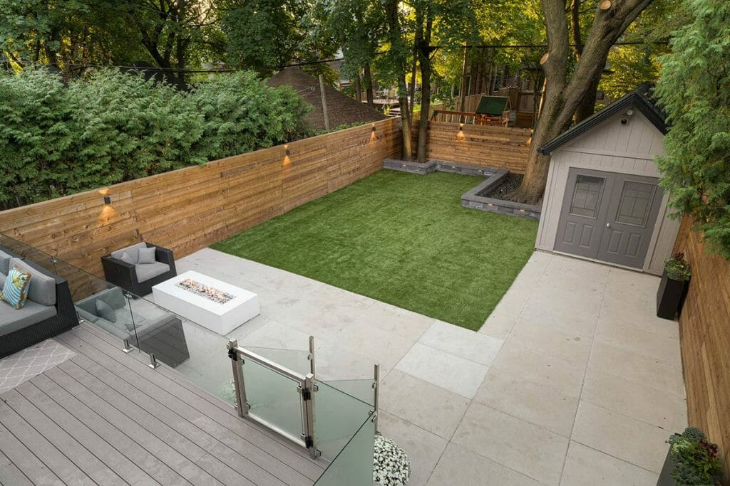 Complete Landscaping Design Project; Featuring Small Composite Deck Build, Privacy Fence, Interlocking, Small Retaining Wall & Outdoor Fireplace