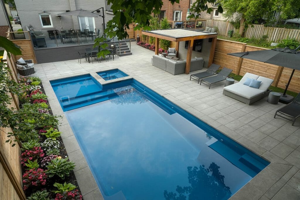 Complete Landscaping Toronto Project; Featuring Fiberglass Pool, Pool Deck Interlocking, Composite Decking, Woodworking & Privacy Fence