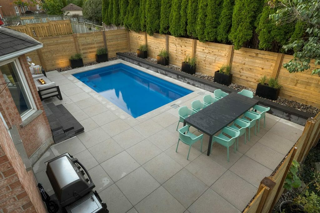 Complete Toronto Backyard Landscaping Project; Featuring Concrete Pool, Interlocking, Retaining Wall & Cedar Privacy Fence