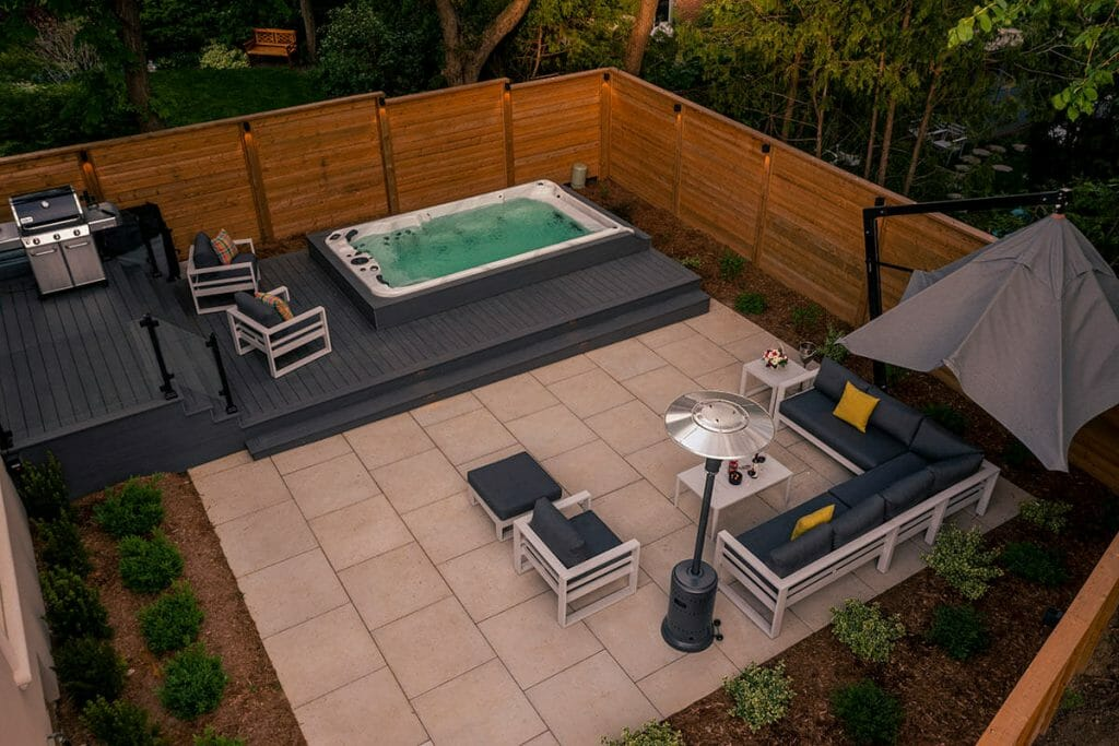 Complete Toronto Landscaping Project; Featuring Interlocking, Spa Pool Installation, Fence Build, PVC Decking, Patio Design, with Glass and Aluminum Railings by M.E. Contracting