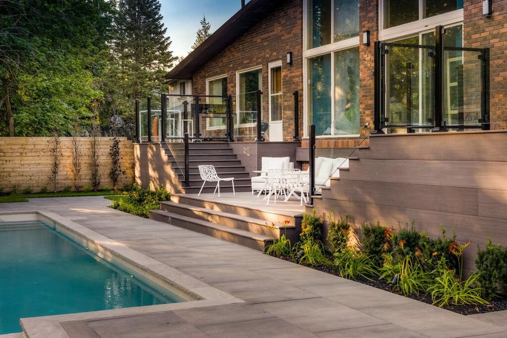 Toronto Landscaping Design & Decking Project; Featuring PVC Decking, Cedar Fencing, Interlocking, Fiberglass Pool, Aluminum & Glass Railings.