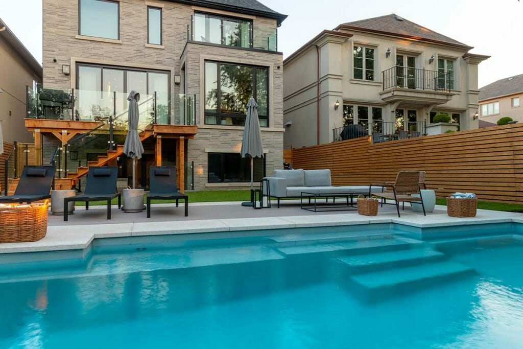 Completed Landscaping Project, by the Experts at M.E. Contracting; Featuring Fiberglass Pool Installation, Pool Deck Interlocking, Softscape, Patio Design & Decking.