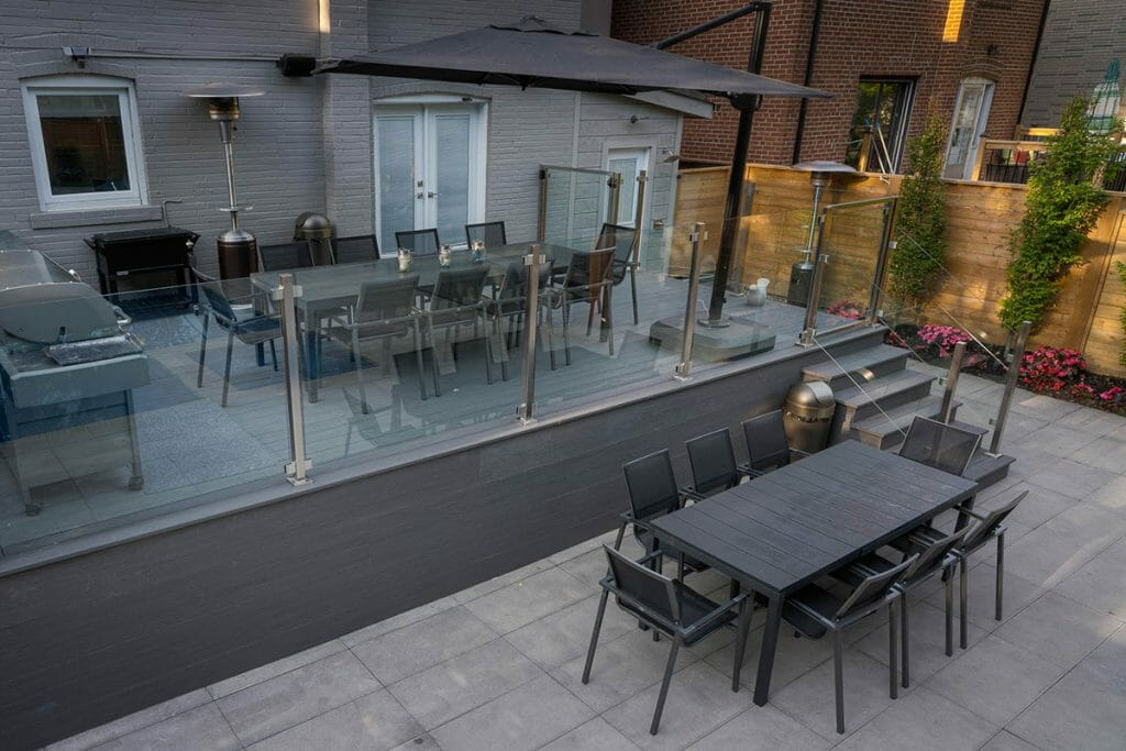 Composite Decking Project by Toronto Landscaping; Featuring Composite Deck, Stainless Steel & Glass Railings, Interlocking & Fence Woodworking.