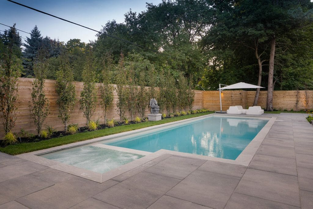 Concrete Pool Installation with Pool Deck Interlocking, Privacy Fence by M.E. Contracting