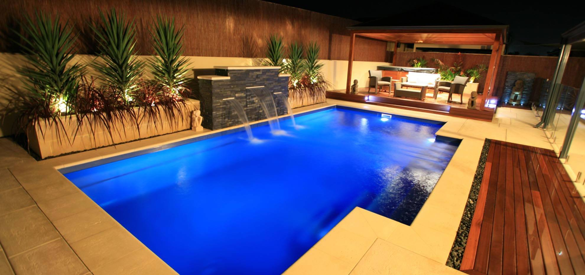 Elegance design fibreglass pool with water feature and coping by Leisure Pools