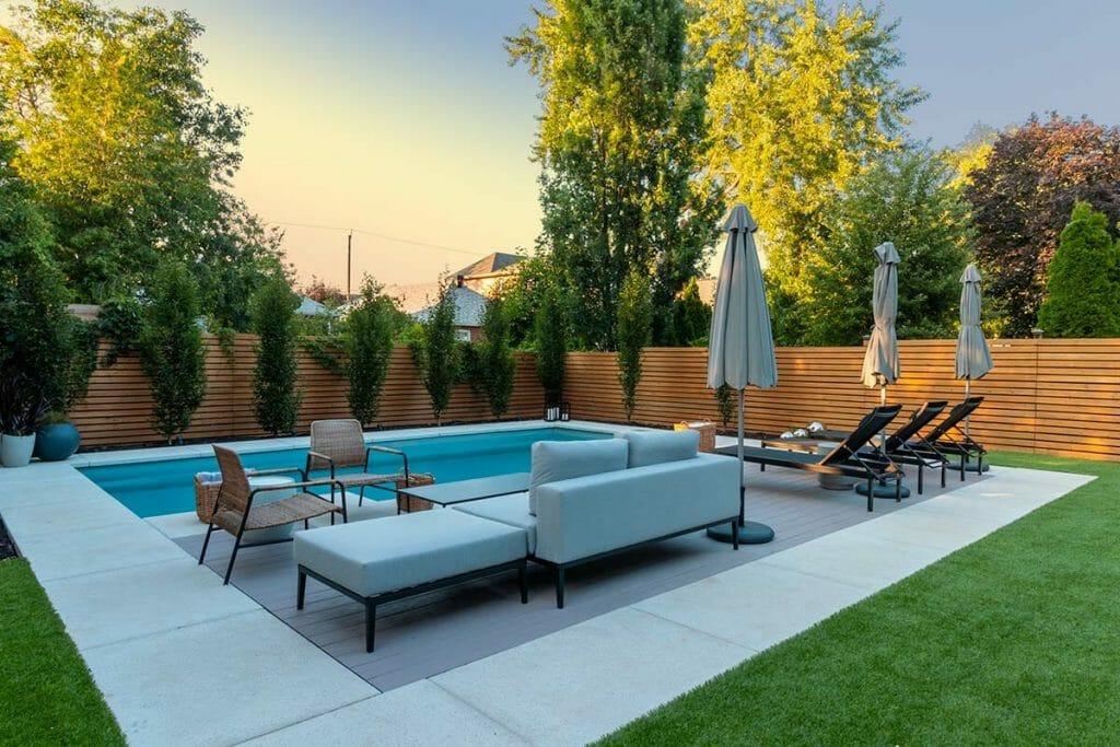 Fiberglass Pool Installation & Landscape Design Project for Toronto Home with Pool Deck Interlocking, Patio Design, PVC Decking & Softscape.
