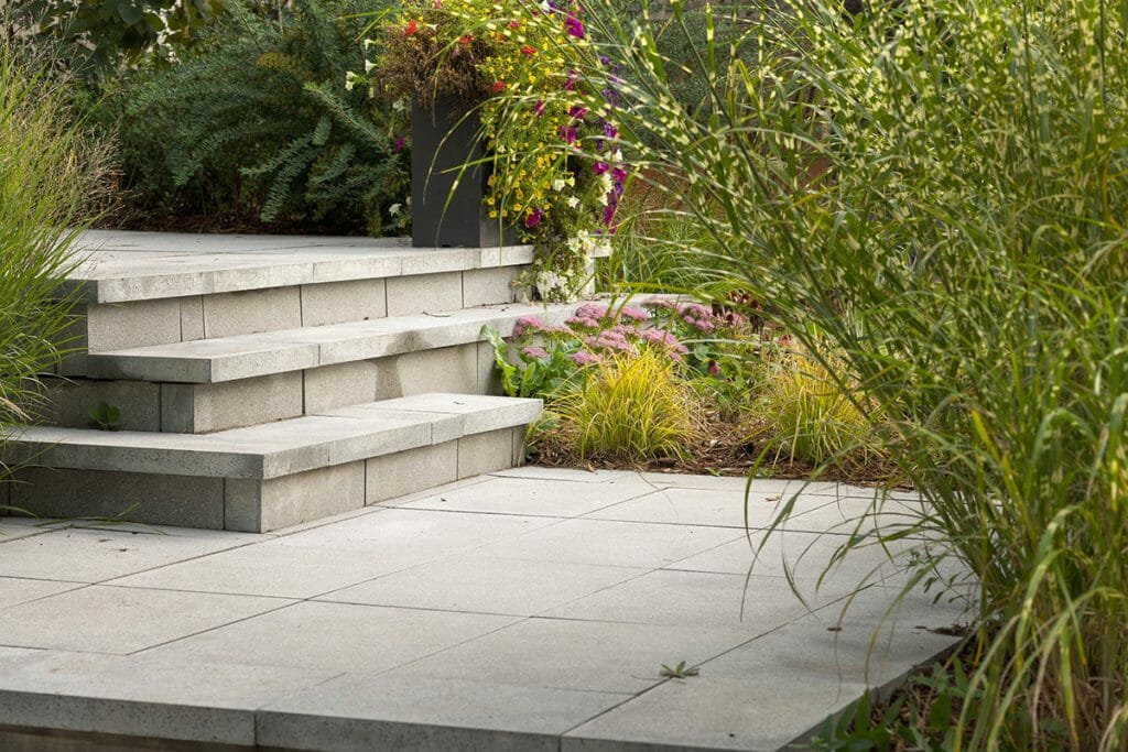 Modern Front Entrance Landscape Design & Interlocking Project by M.E. Contracting.