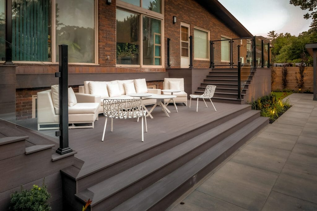 PVC Decking Project by The Toronto Landscaping Company; Featuring Landscape Design, PVC Deck with Aluminum & Glass Railings.