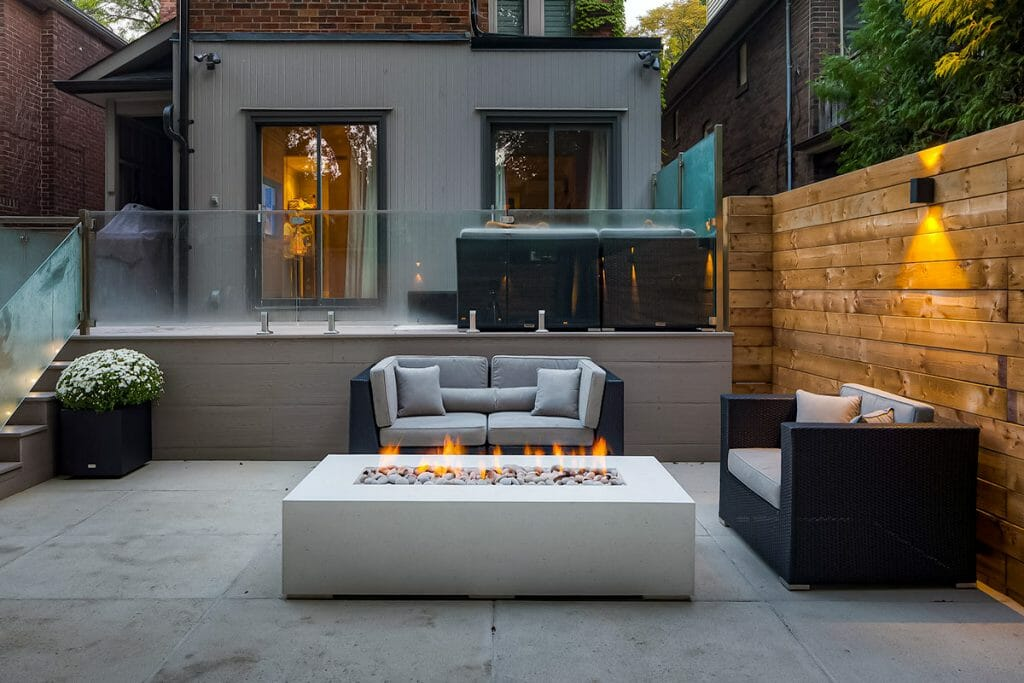 Hillhurst Project; Featuring Tempered Glass & Stainless Steel Railings, Composite Decking, Patio Interlocking & Outdoor Fireplace.jpg_
