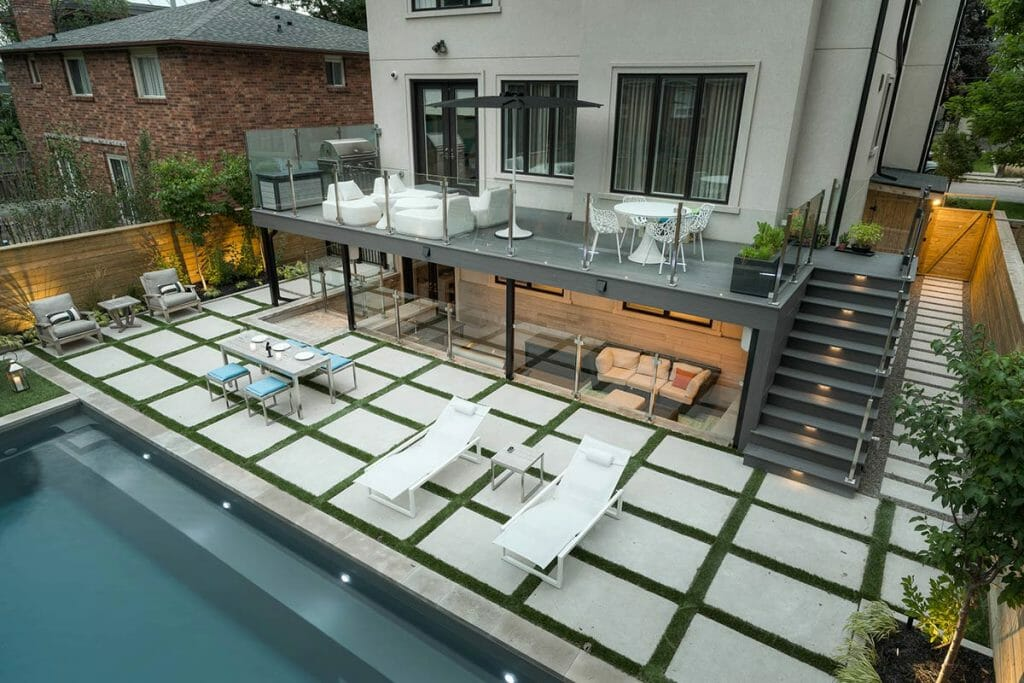 Joicey Blvd, Toronto Landscaping Project for Medium Sized Backyard; Featuring Fiberglass Pool Installation, Interlocking, Decking, Outdoor Kitchen & Stainless Steel Glass Railings