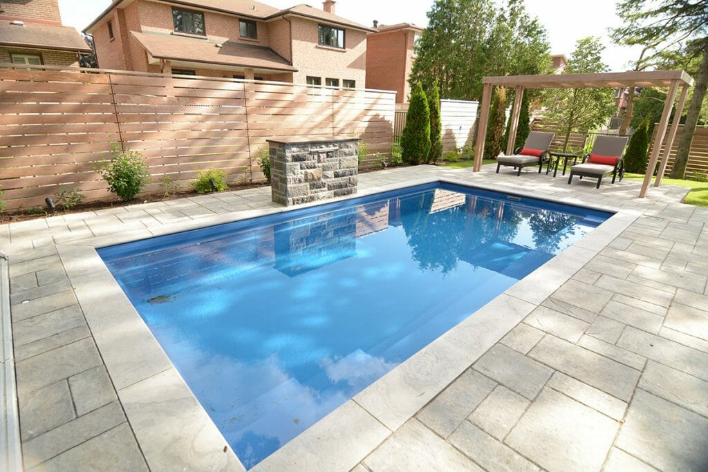 M.E. Contracting; Complete Reflection Fiberglass Pool with Water Feature, Interlocking & IPE Privacy Fence Backyard Project.