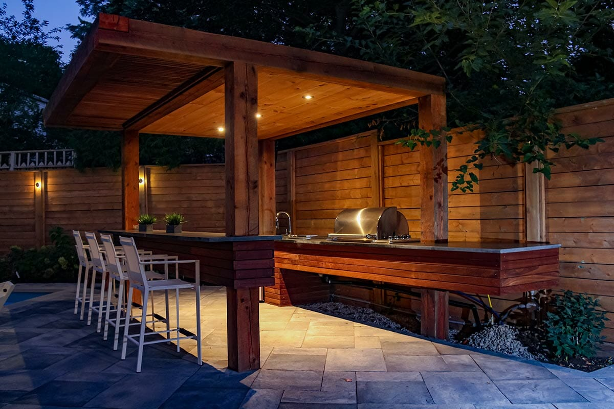 Woodworking Pergola & Outdoor Kitchen Feature; Complete Landscaping Project by Toronto Landscaping Company.