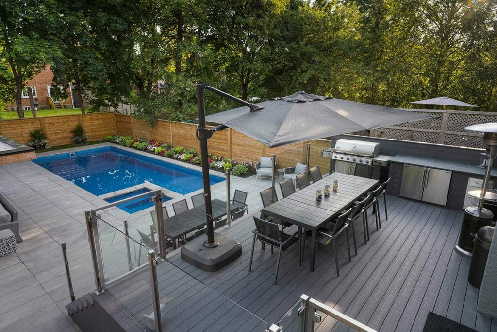 Lyonsgate Landscape Design Project; Featuring Composite Decking, Stainless Steel Railings, Fiberglass Pool, Privacy Fence & Outdoor Kitchen