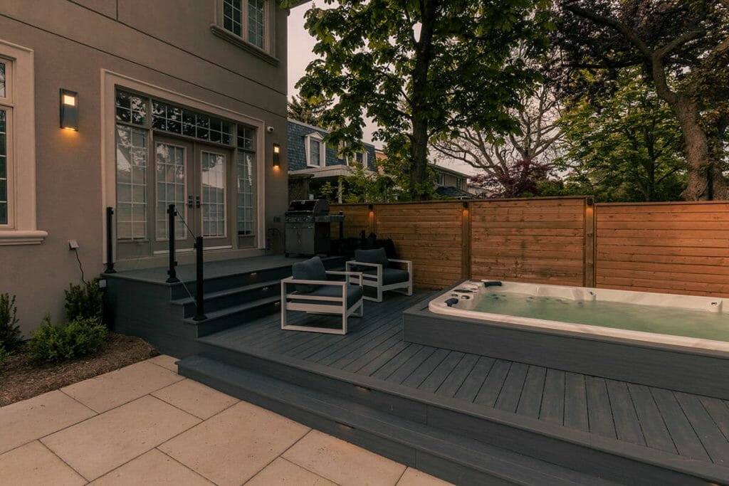 M.E. Contracting Landscaping Project; Featuring Interlocking, Decking with Glass & Aluminum Railings, Fencing, and Small Spa Pool Installation