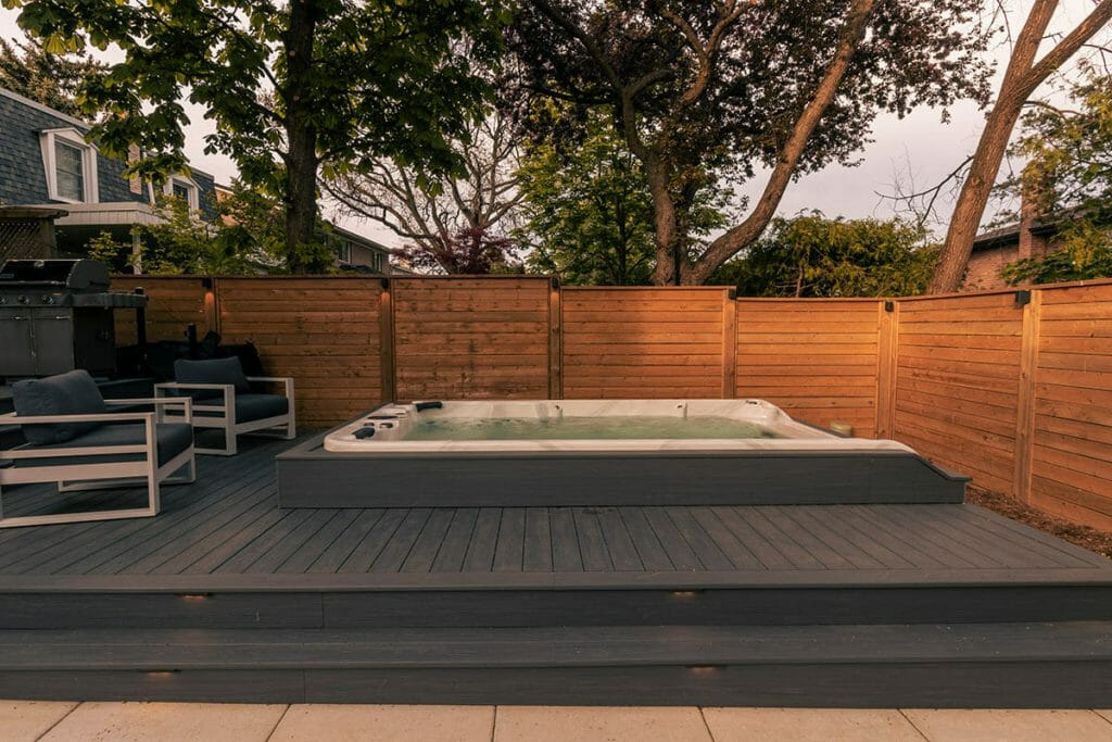 M.E. Contracting Landscaping Project; Featuring PVC Decking & Fencing with Small Spa Pool Installation