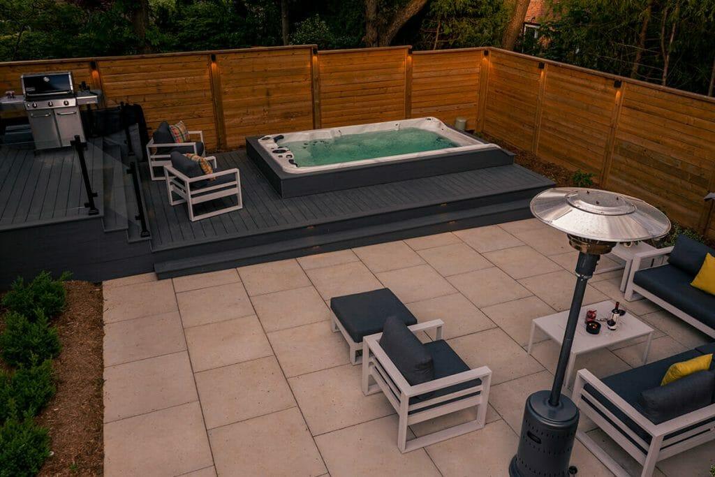 M.E. Contracting; Premium Landscaping Project; Featuring Interlocking, Patio Design with PVC Deck Build, Swim Spa Installation & Lighting