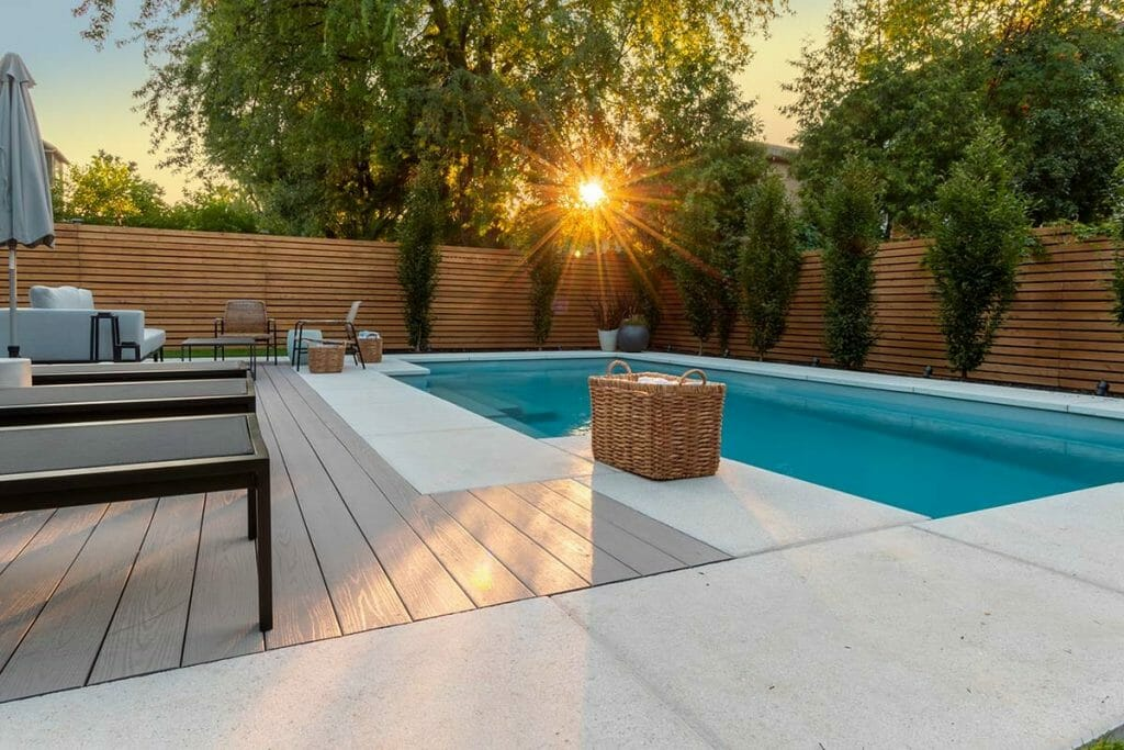 M.E. Contracting, Small Backyard Landscaping Project with PVC Decking, Stone Interlocking, Fiberglass Pool Installation and Landscape Design