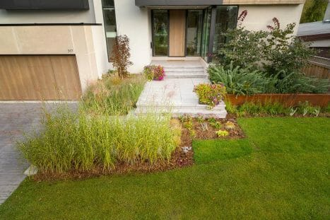 Modern Landscape Design Project; Featuring Front Entrance Interlocking Steps, Soft Scaping & Retaining Wall by Toronto Landscaping Company.