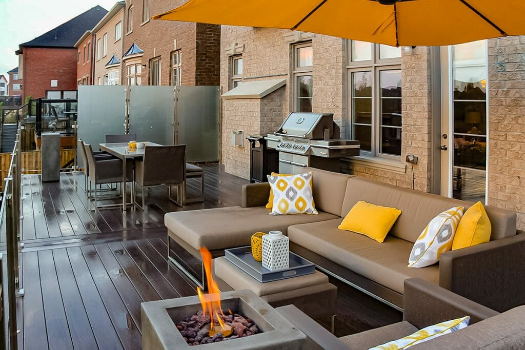 Toronto Landscaping Project; Featuring PVC Decking, Outdoor Fireplace, Stainless Steel & Glass Railings.