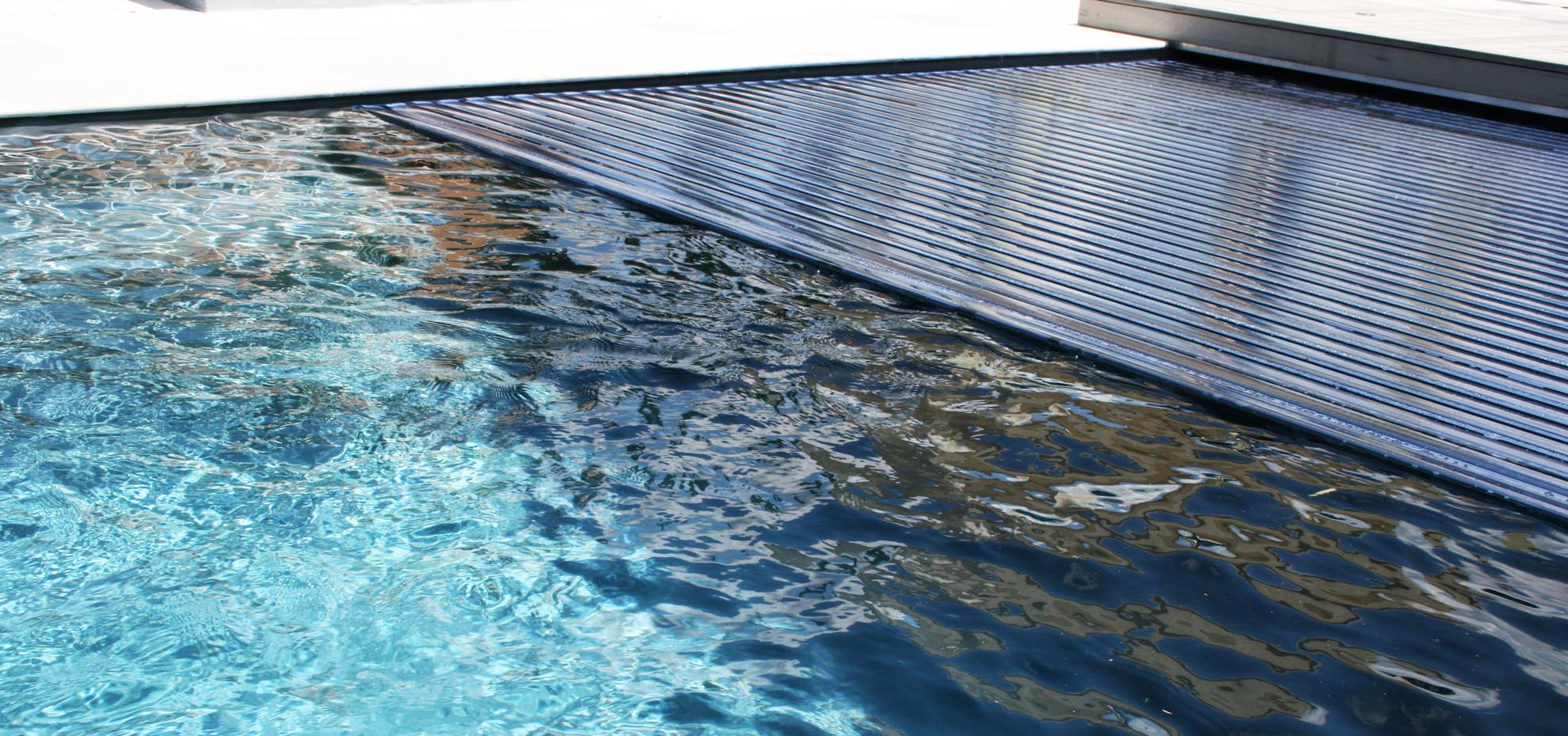 The Reflection Auto Cover Fiberglass pool by Leisure Pools