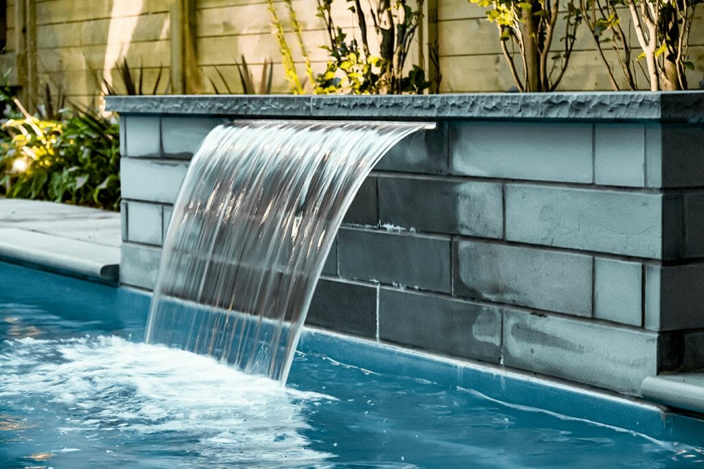 Sekler Residence; Toronto Landscaping Project, Fiberglass Pool Installation with Water Feature