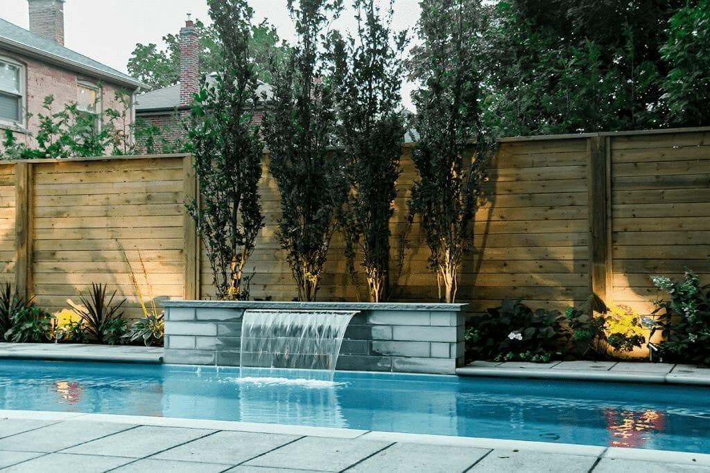Sekler Residence, Toronto Landscaping Project with Fiberglass Pool & Water Featuring, Interlocking & Cedar Fencing