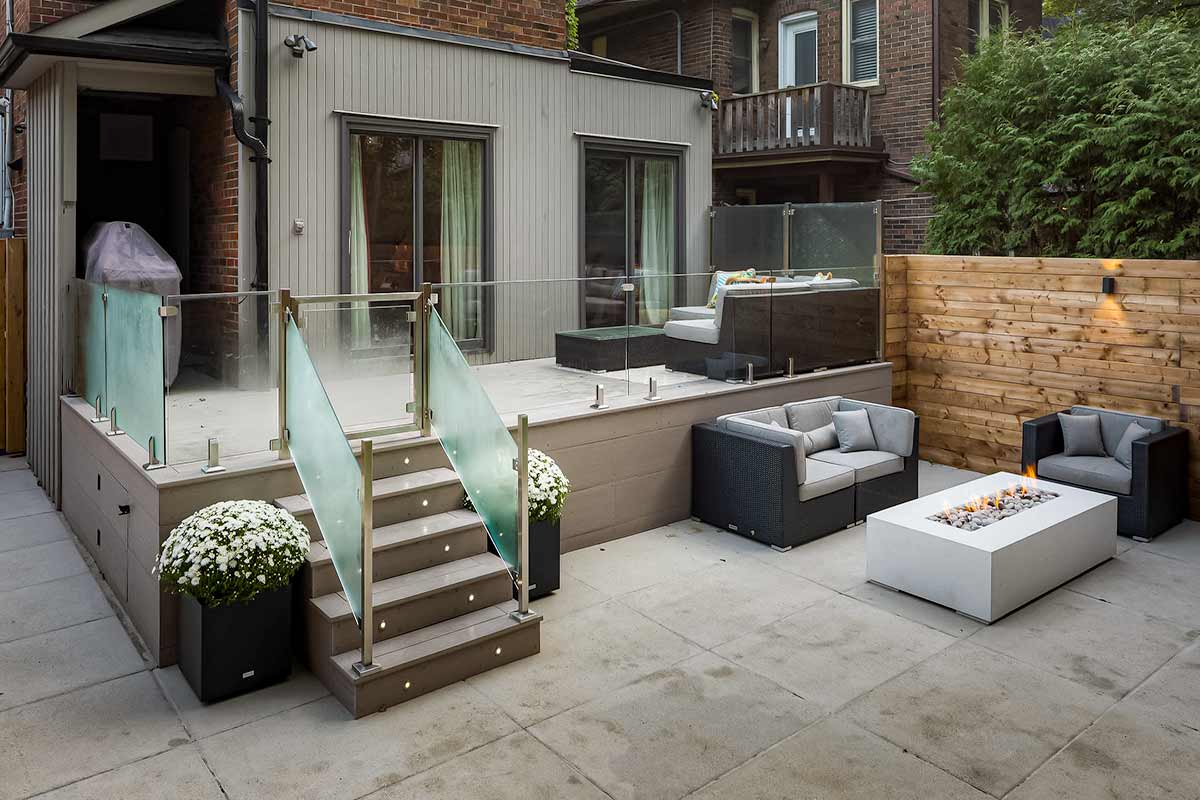 Small Backyard Landscaping Project by Toronto Landscaping Company; Featuring Small Composite Deck Build with Stainless Steel Railings