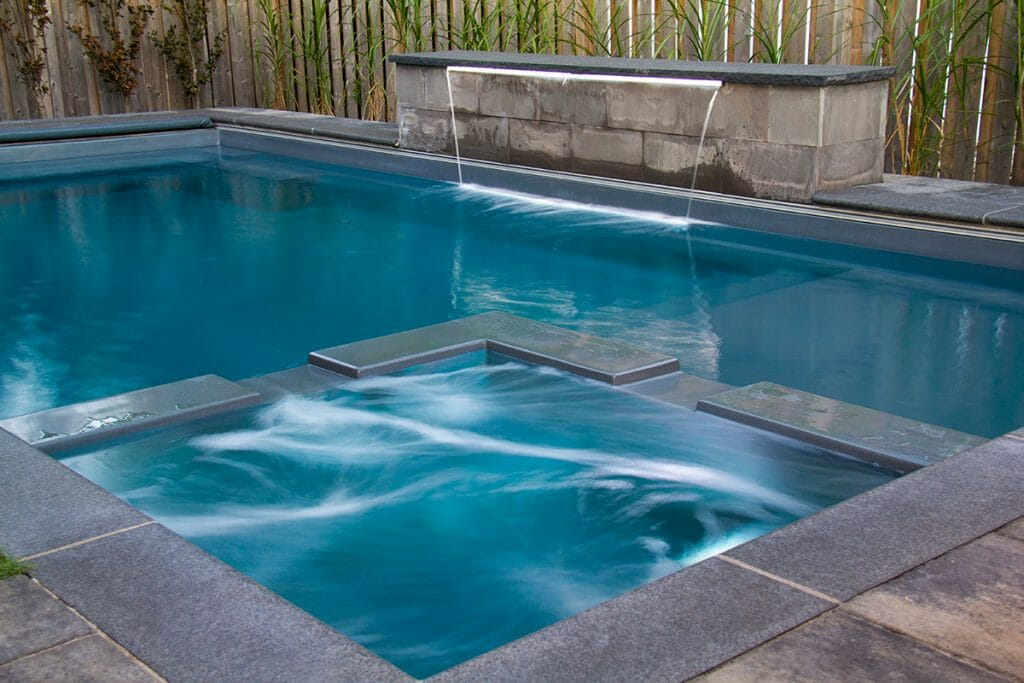Small Fiberglass Reflection Pool Installation Project by M.E. Contracting.