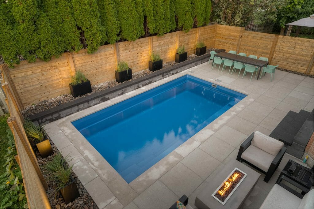 Small Toronto Backyard Landscape Design Project with Concrete Pool, Interlocking, Privacy Fence & Retaining Wall