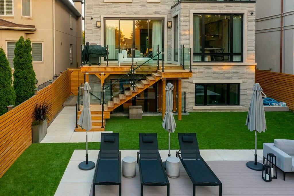 Small Toronto Backyard Landscape Design Project with Stone Pool Deck Interlocking, PVC Decking & Patio Design by M.E. Contracting.