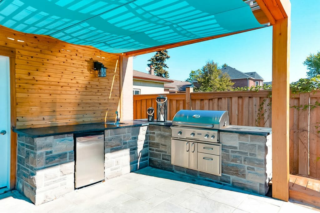 Small Toronto Landscape Design & Pool Construction Project by M.E. Contracting.