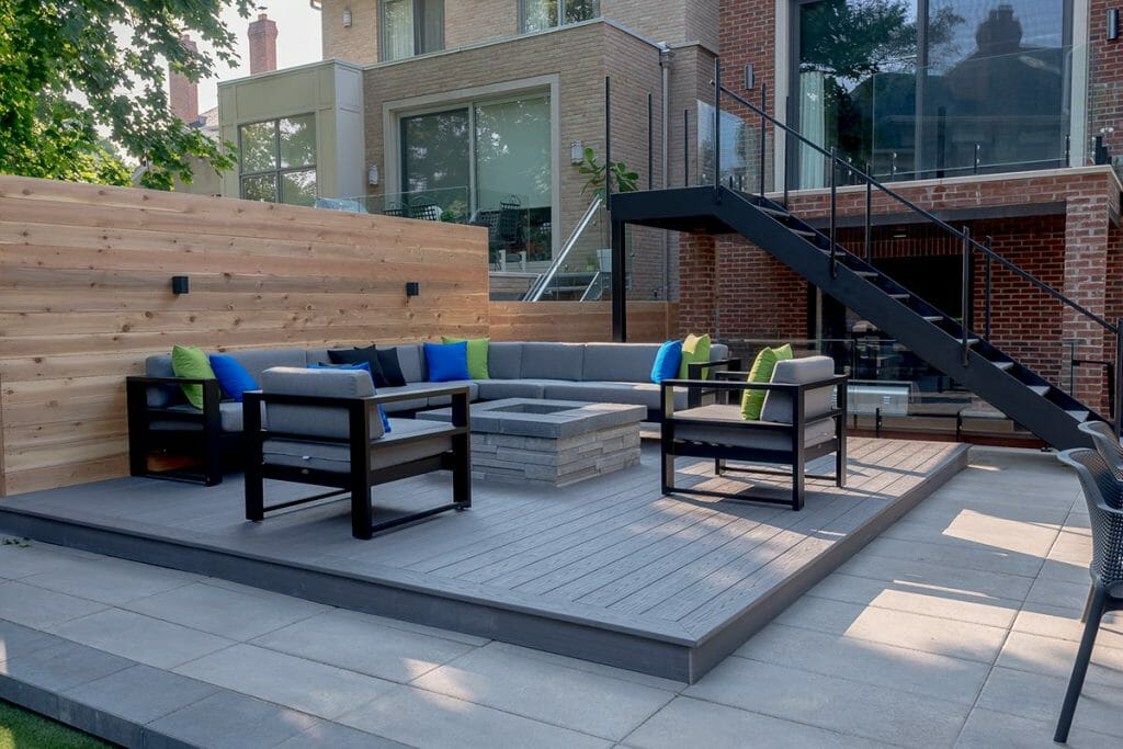 Small Toronto Patio Design Project; Featuring Outdoor Fireplace, Interlocking & Privacy Fence