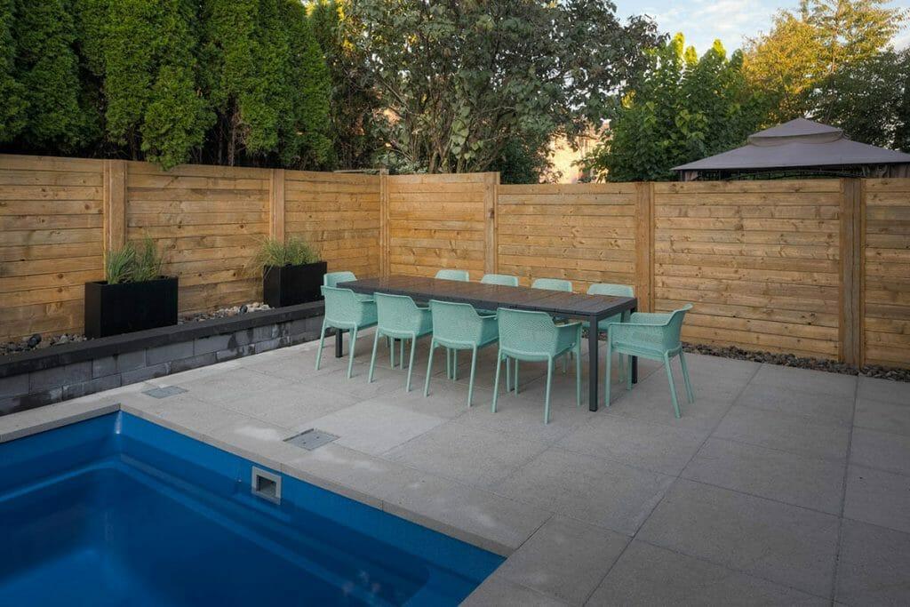 Toronto Backyard Patio Design & Concrete Pool Installation with Privacy Fence & Retaining Wall