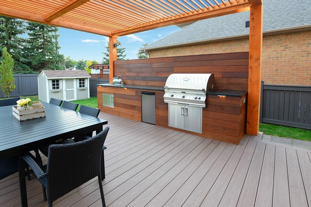 Toronto Landscaping Contractors, Composite Decking Project; Featuring Patio Design, Outdoor Kitchen & PVC Privacy Fence.
