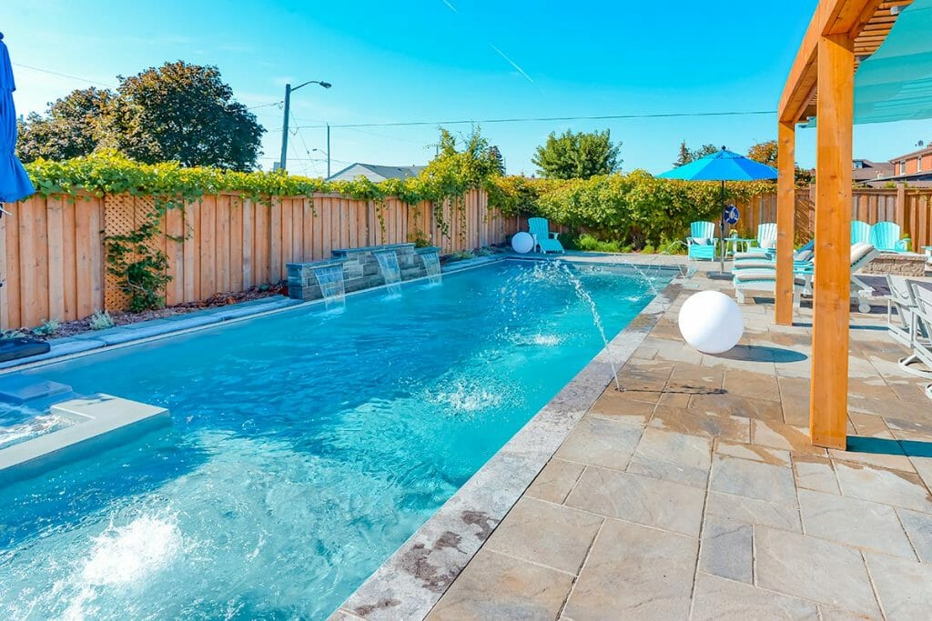 Toronto Fiberglass Pool Installation with Water Features, Pool Deck Interlocking by M.E. Contracting.