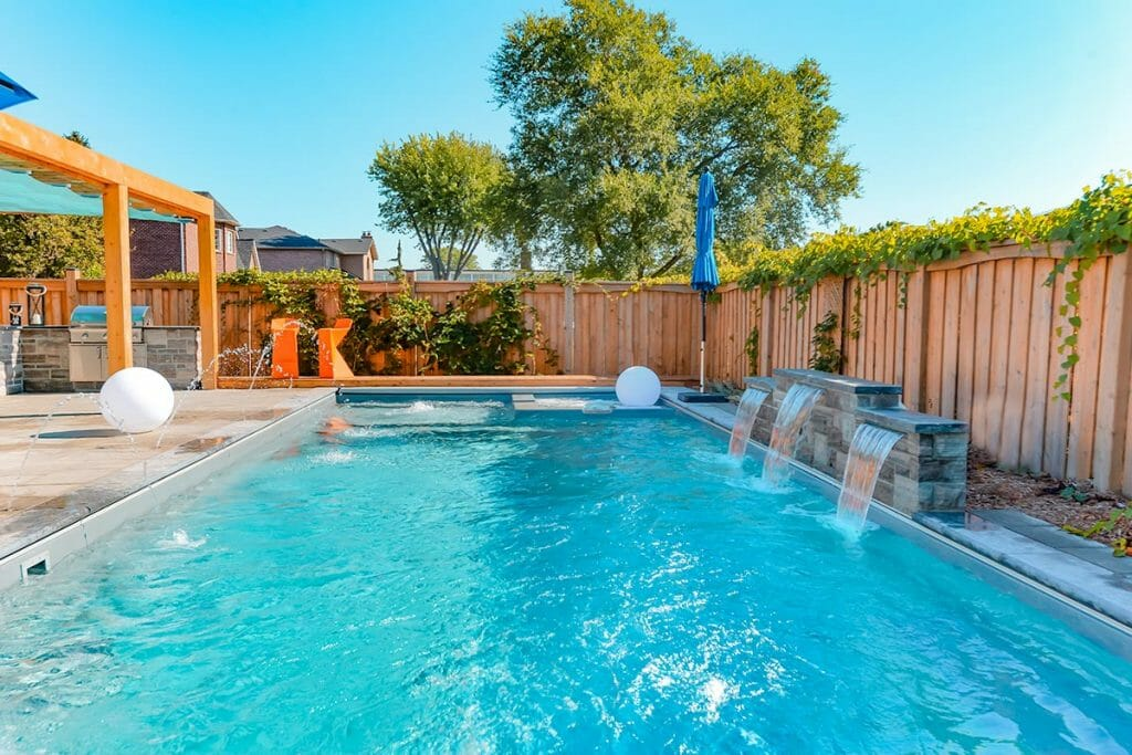Toronto Fiberglass Pool with Water Features Installation & Landscape Design; M.E. Contracting.