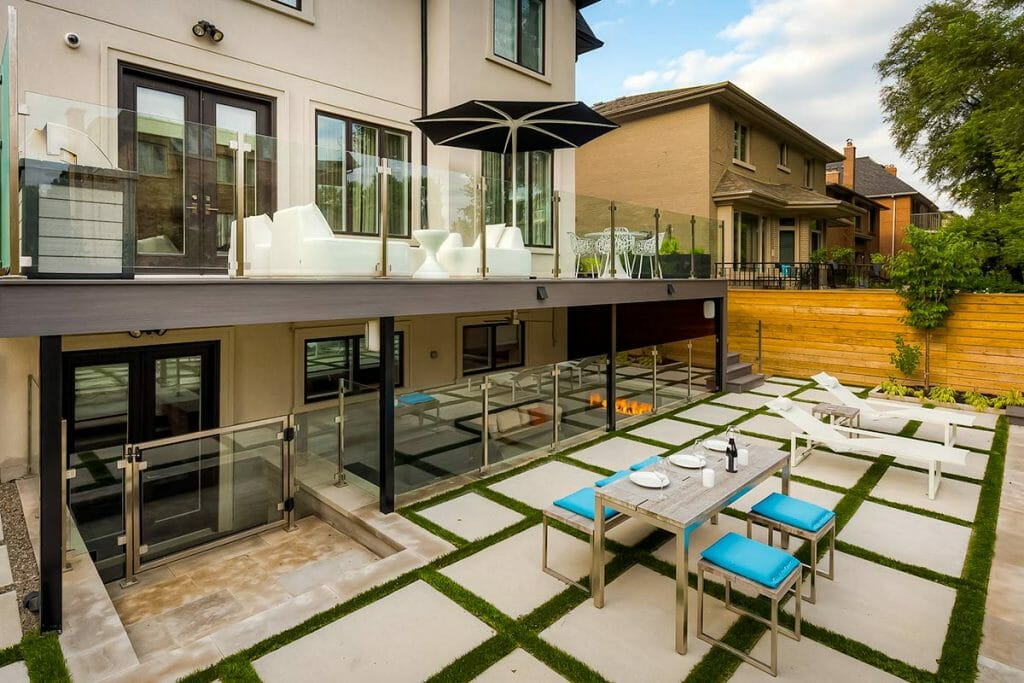 Toronto Landscape & Deck Building Project by M.E. Contracting; Featuring Outdoor Fireplace, Interlocking & Stainless Steel Glass Railings - Joicey Blvd