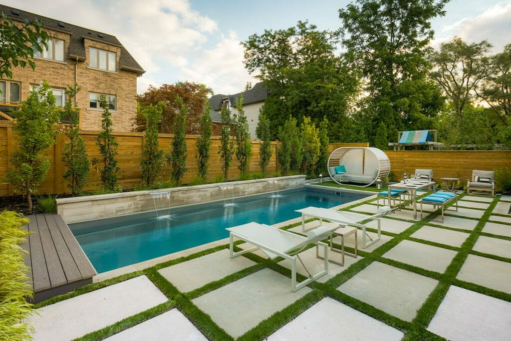 Toronto Landscape Design & Contracting Project with Interlocking, Fiberglass Pool, Privacy Fence & Small Retaining Wall