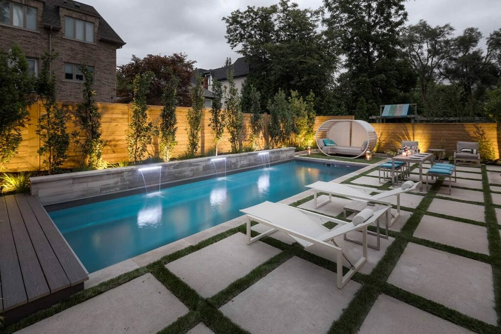 Toronto Landscape Design; Featuring Fiberglass Pool, Interlocking, Retaining Wall & Privacy Fence by Toronto Landscaping Company