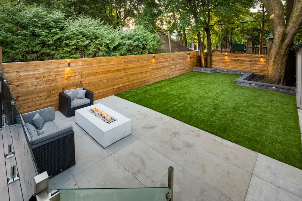 Toronto Landscape Design Project with Outdoor Fireplace, Small Composite Deck, Stainless Steel & Glass Railings