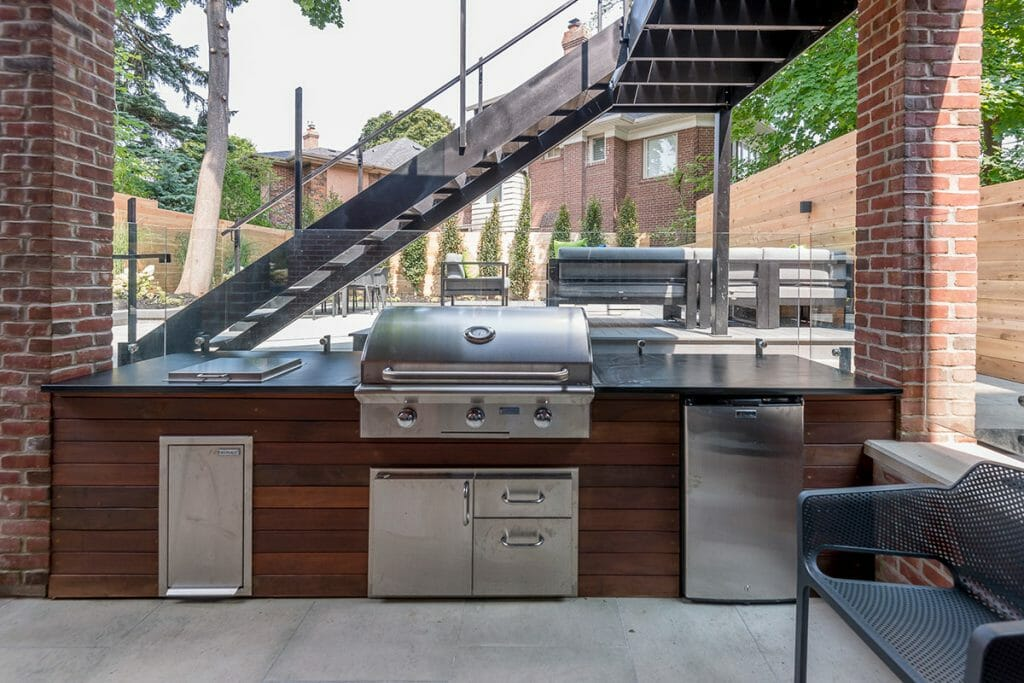 Toronto Landscape Design with Outdoor Kitchen & Wrought Iron Railings