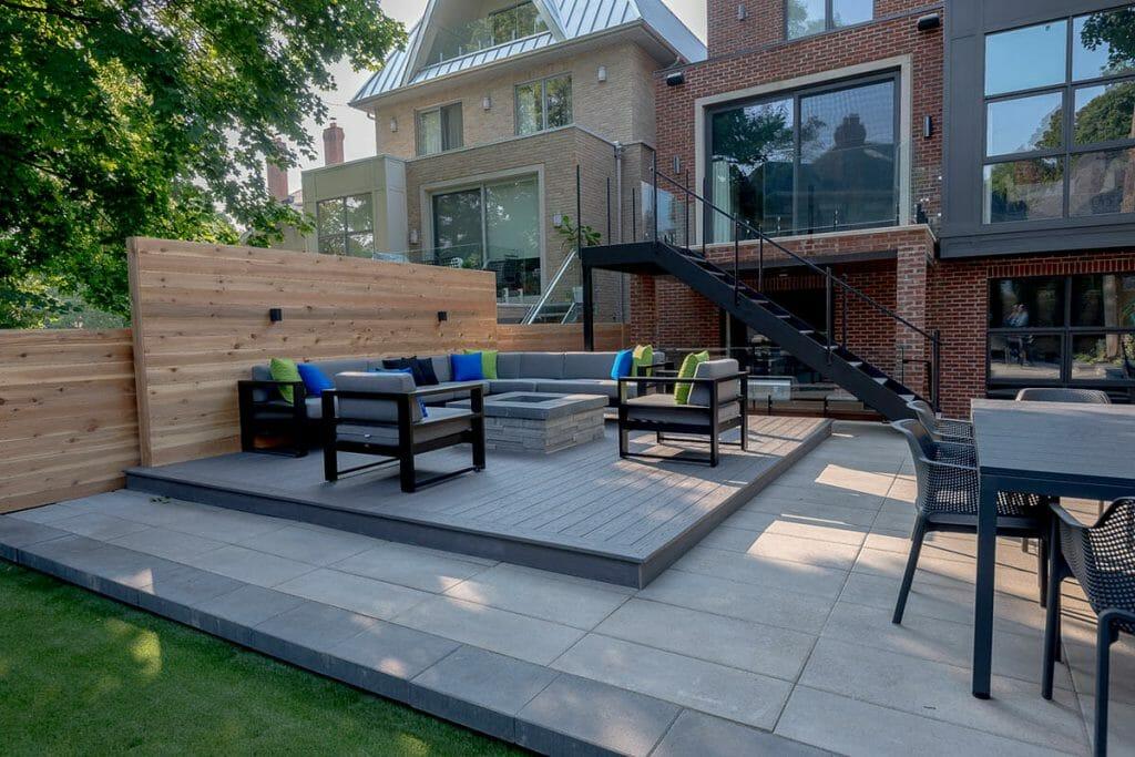 Toronto Landscape Design with Patio Design, Outdoor Fireplace, Decking & Wrought Iron Glass Railings & Interlocking