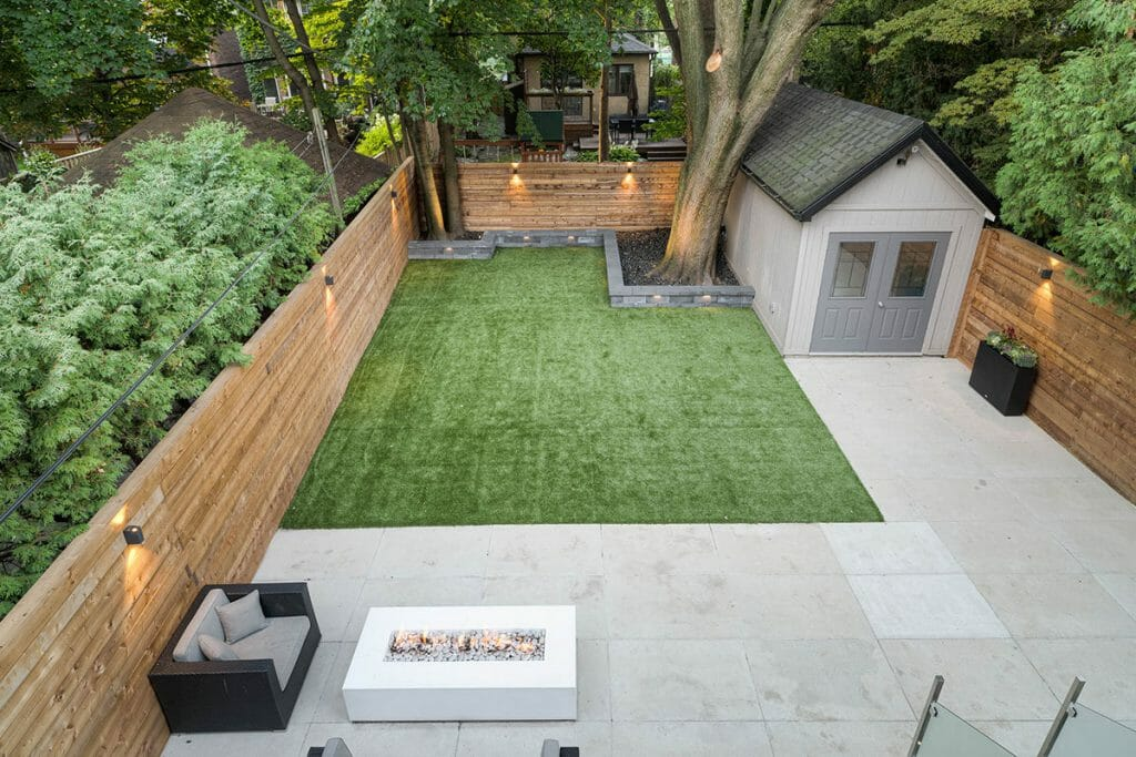 Toronto Landscape Project with Retaining Wall, Outdoor Fireplace & Privacy Fence for Small Backyard