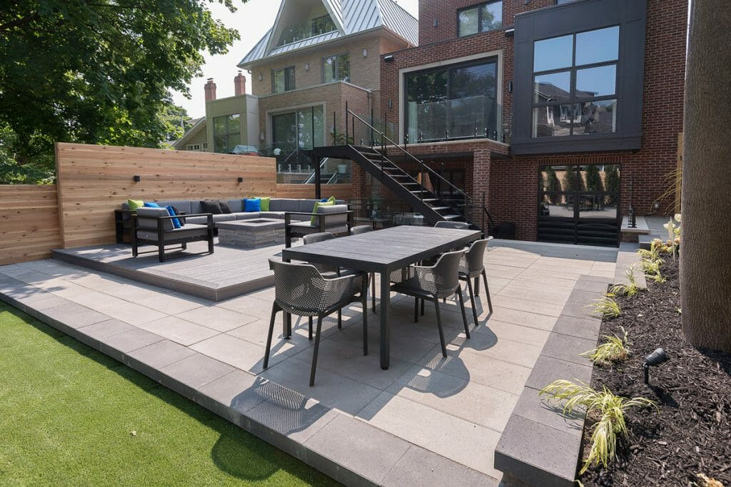 Toronto Landscaping Company; Patio Design Project with Interlocking, Composite Deck Build, Outdoor Fireplace & Wrought Iron Railings